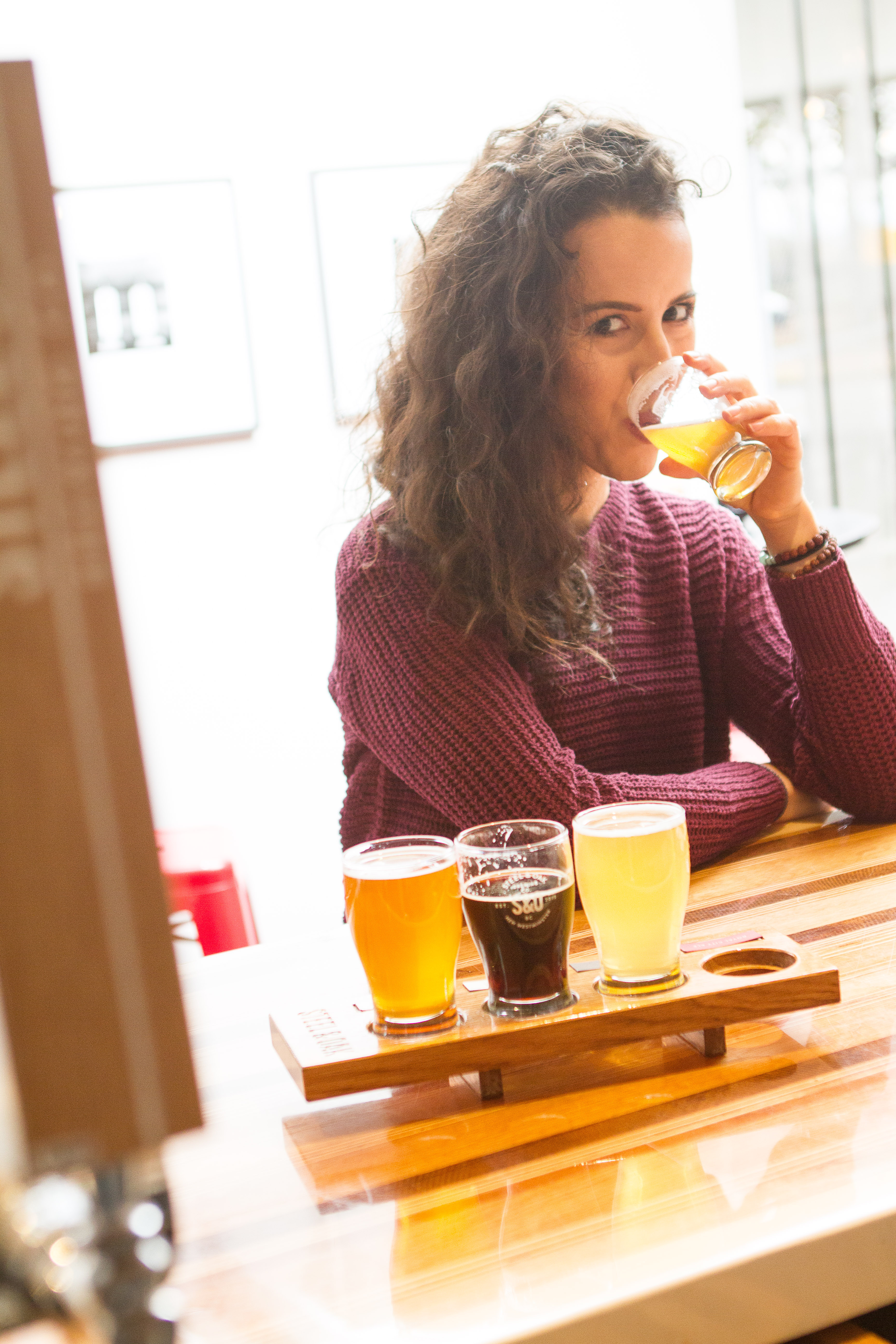 Girl drinking craft beer