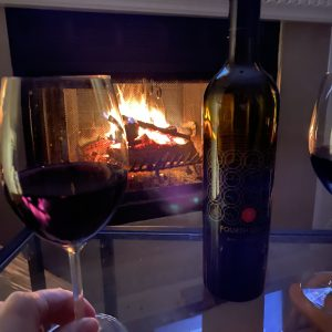 Wine Thursday TIME winery Fourth Dimension wine in front of a fireplace