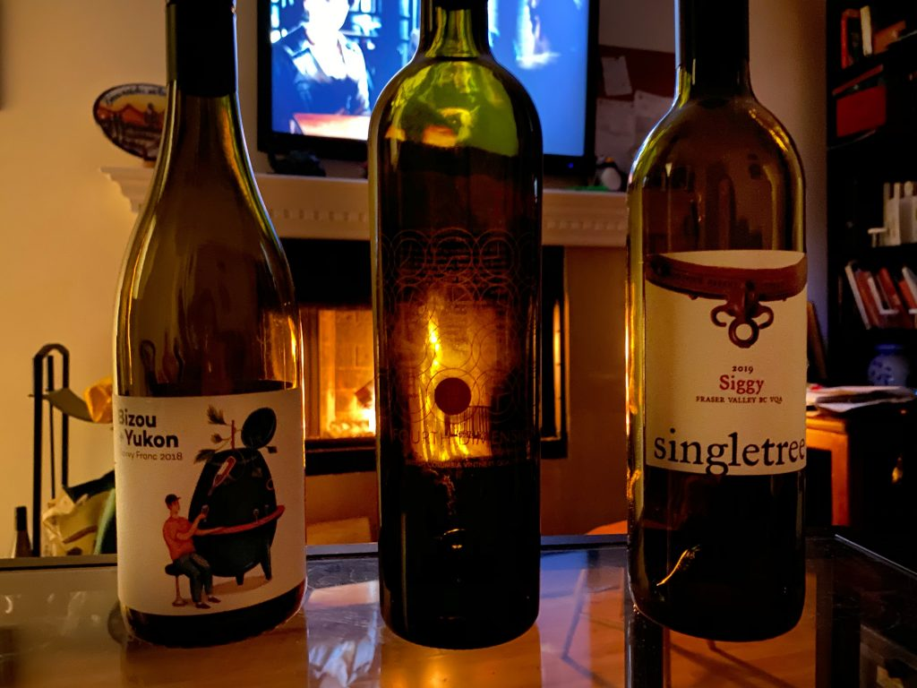 Wine Thursday - three wine bottles in front of a fireplace